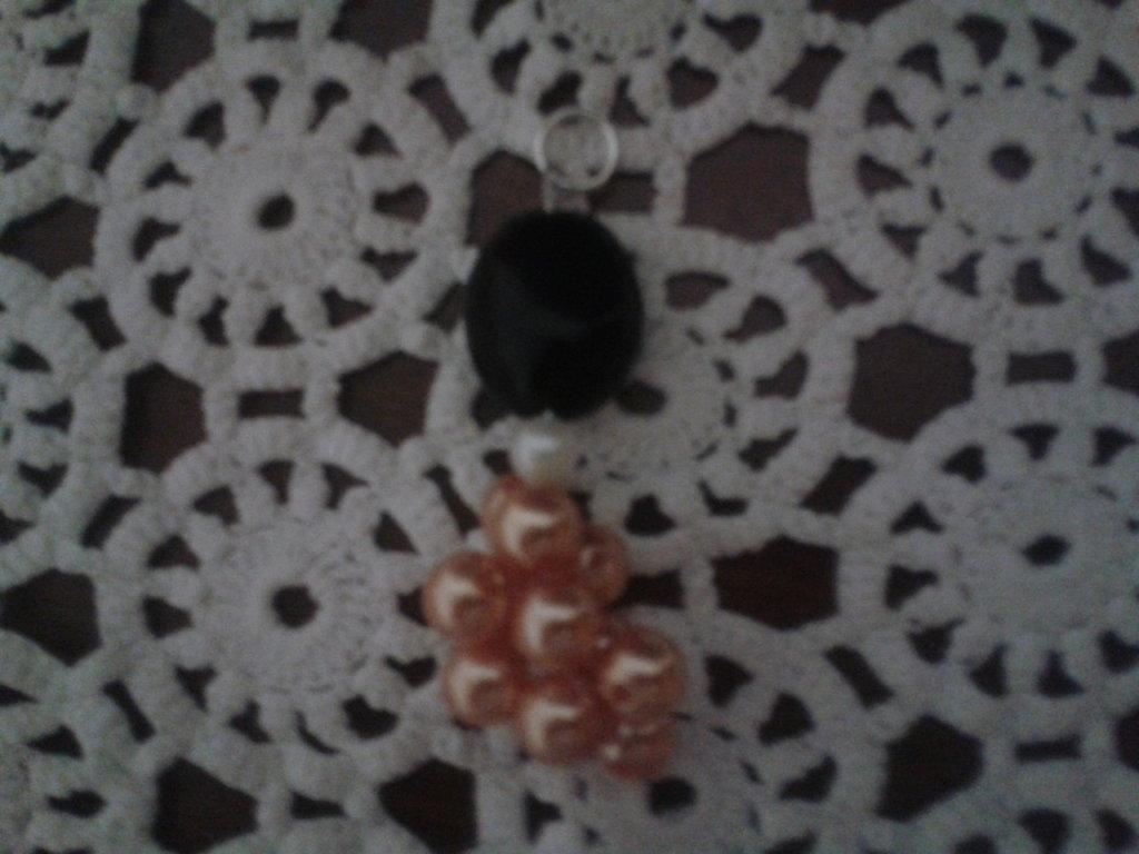 Pendente per collana con perle intrecciate