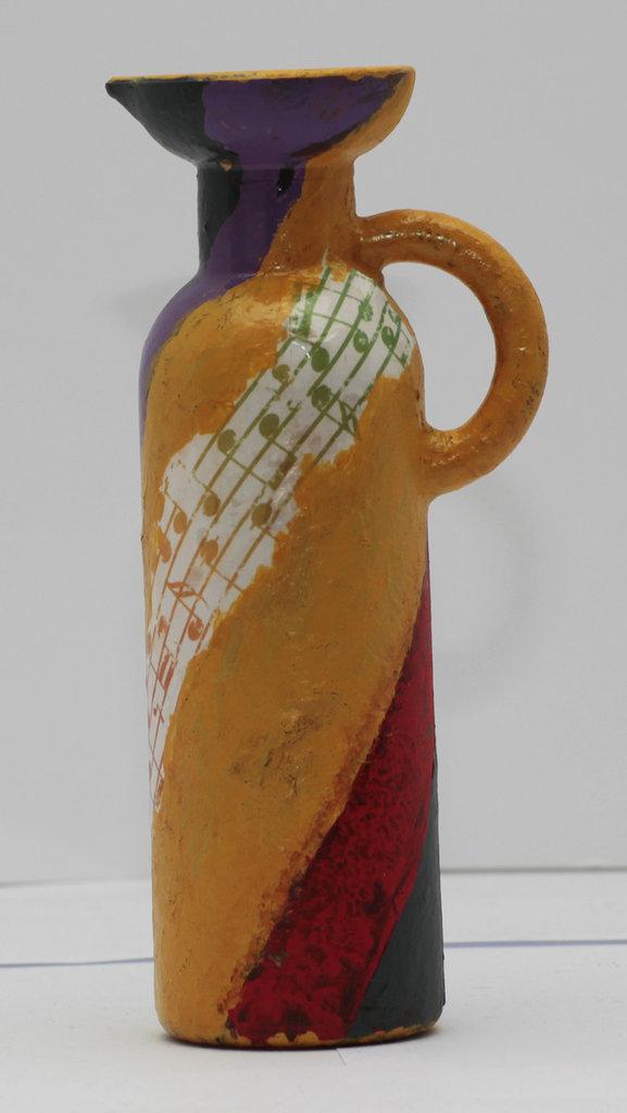 Bottiglietta porta essenze con note musicali
