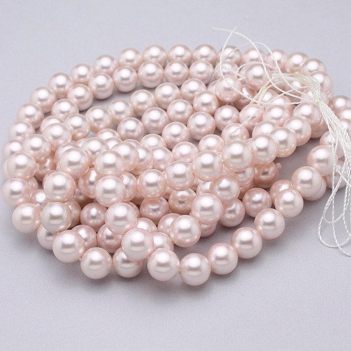 filo perle di conchiglia rosa