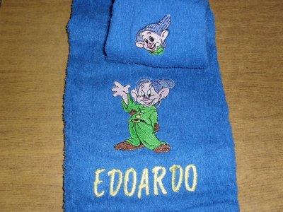 asciugamano + ospite
