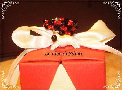 Anello armonico mezzo cristallo nero e perline rosse