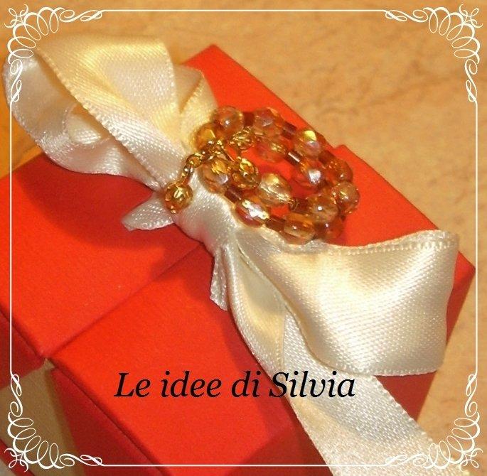 Anello armonico cristalli champagne e perline marroni