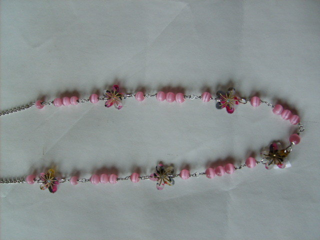 collana occhi di gatto rosa e fiori resina