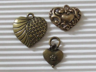 3 charms cuore in bronzo