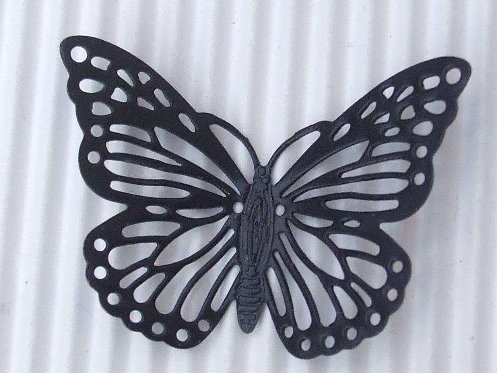 1 farfalla nera in metallo 35x27mm vend.