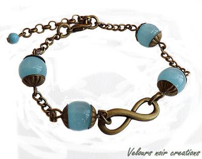 Bracciale simbolo infinito  bronzo perle azzurre vetro vintage