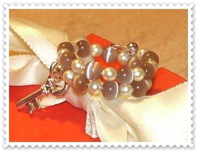 Anello armonico con perle Swarovski e occhio di gatto