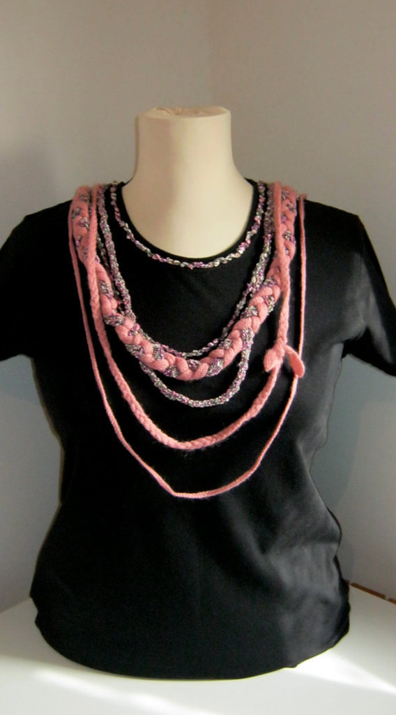 Personalized black xl size short sleeve woman's t-shirt with hand knitted pink application.