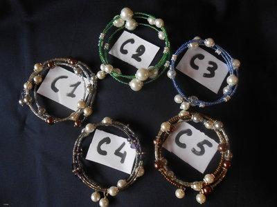 bracciali armonici con perle di vari colori