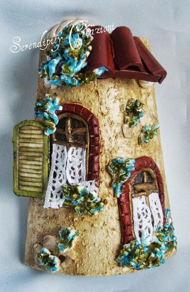 Piccola tegola , casetta azzurra