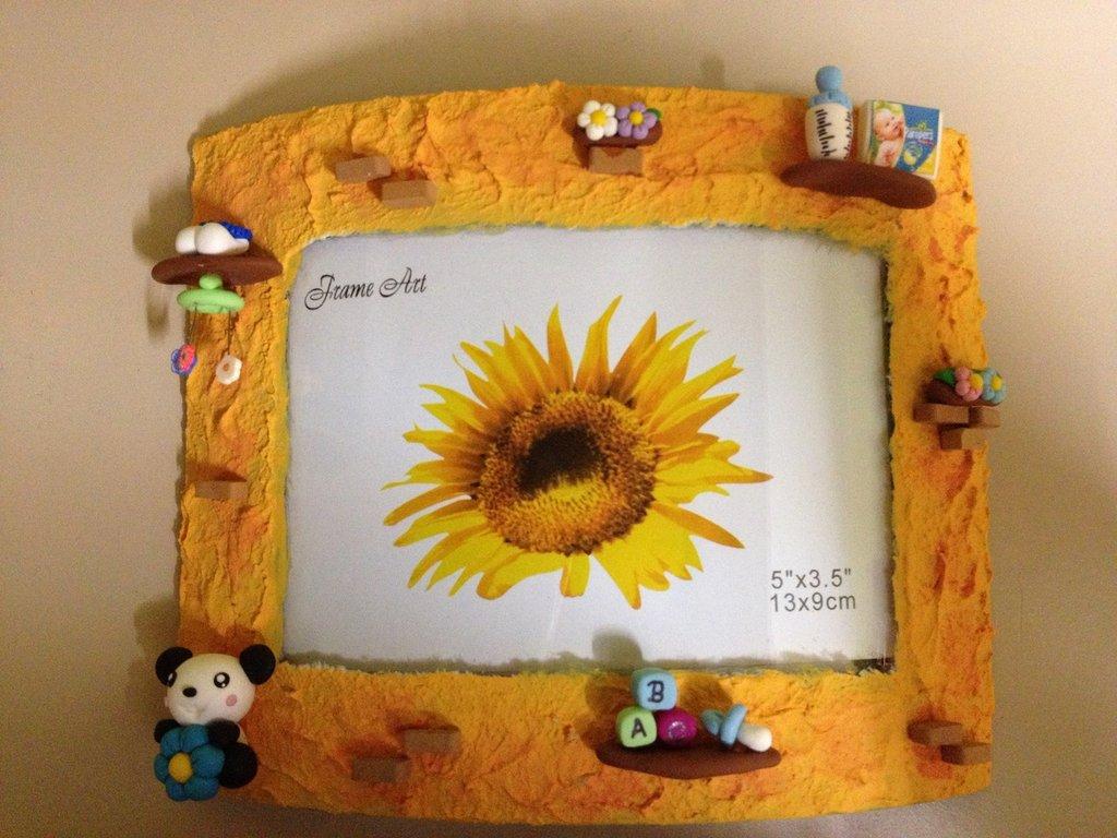 Cornice portafoto con miniature