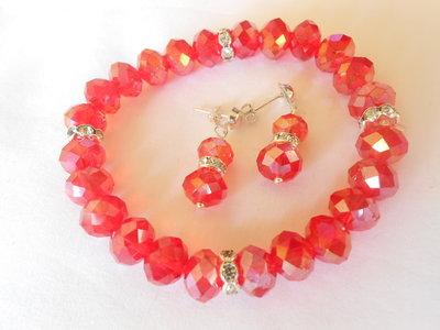 Parure  orecchini e bracciale con cristalli rossi