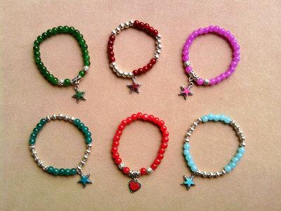 Braccialetti elastici con perle e stelline colorate fimo