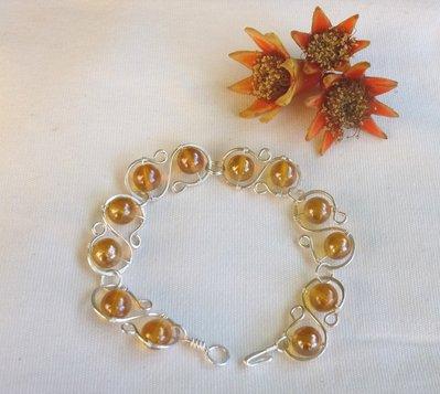 Bracciale con perline di vetro ambra