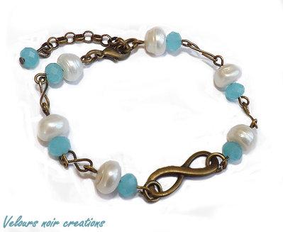 bracciale in bronzo simbolo infinito perle di fiume cristalli