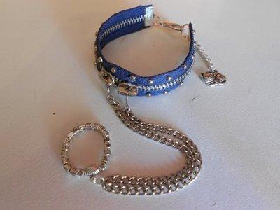 bracciale con borchie e catena anello
