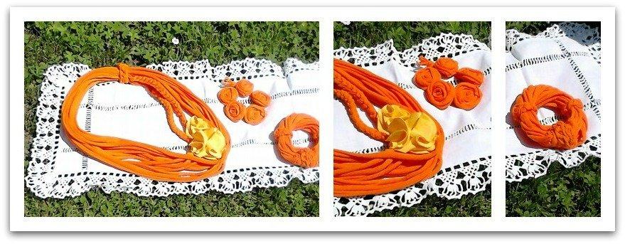 Collana e bracciali arancio con applicazioni