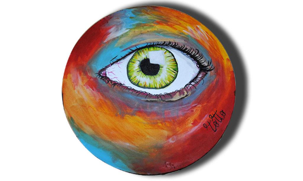 Tela tonda con occhio con sfondo colorato
