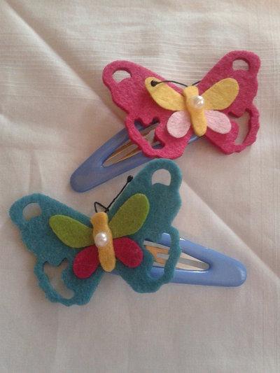 Molletta in plastica con farfalla