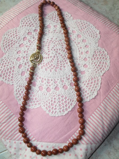 Collana di pietra di sole