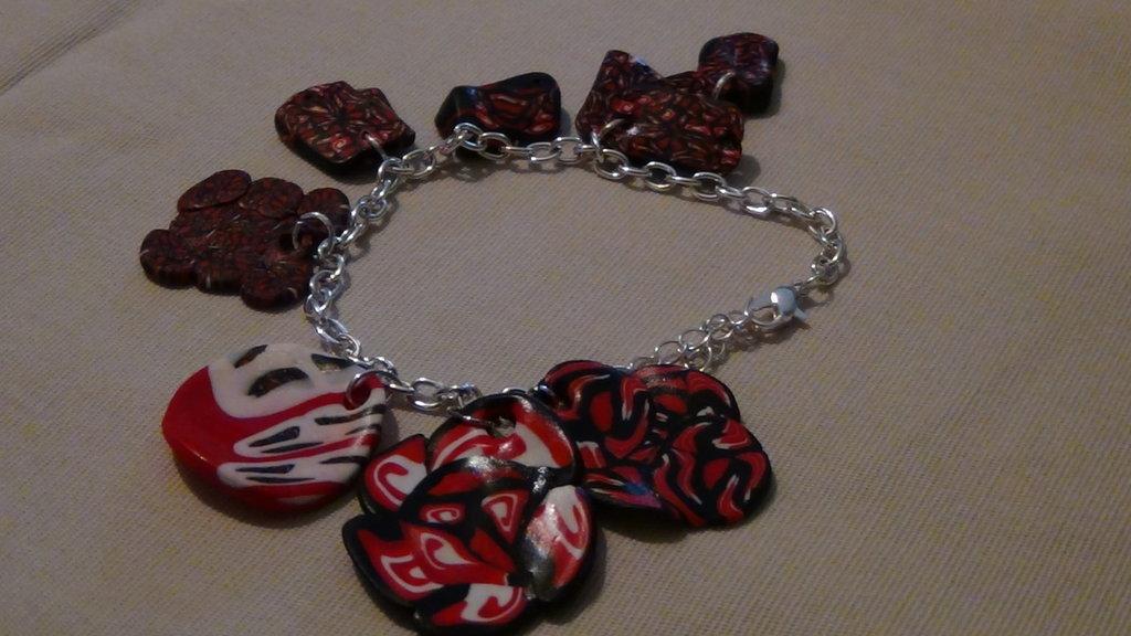 bracciale tempesta di nero e rosso