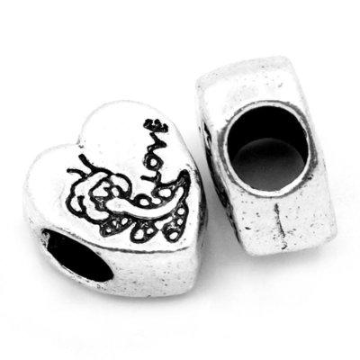 cuore foro largo con  disegno e  scritta love tono argento antico