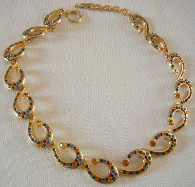 bellissima collana girocollo in metallo dorato e strass