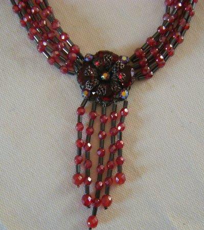 collana multifili con mezzo cristallo e ematite