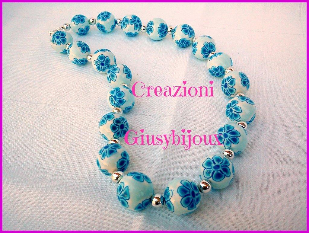 Collana girocollo con perle in fimo murrina fiore petali blu azzur su misshobby - Collane di design ...