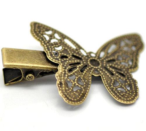 base pinzetta , fermacapelli con farfalla in filigrana. bronzo scontato