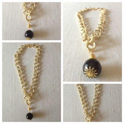 collana con catena dorata e pietre dure