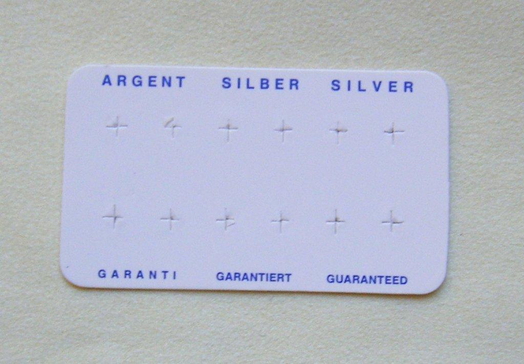 Cartoncini bianchi, in carta lucida,  Espositori per Orecchini con la scritta  argento 925