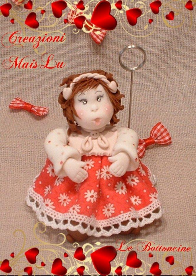 Bambolina in pasta di mais con vestitino in stoffa