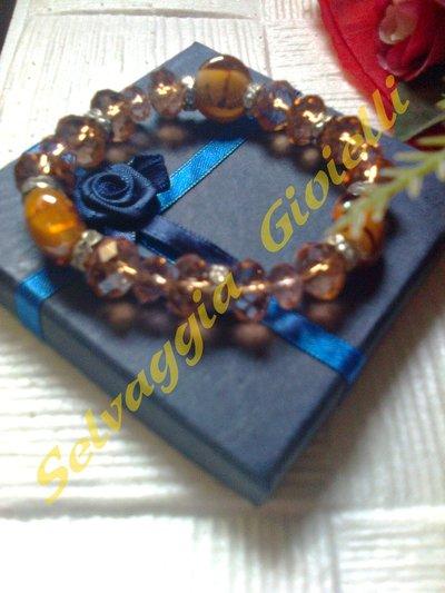 Bracciale elasticizzato con perle in vetro-cristallo