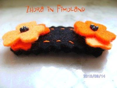 Mollettina a clip rivestita in feltro (100% lana) con fiori