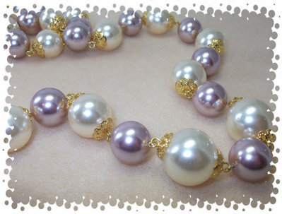Collana lunga con perle