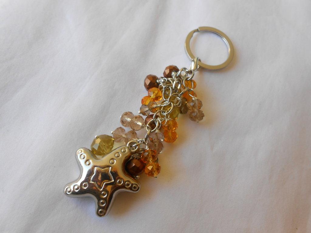 Portachiavi  con cristalli giallo e stella in metallo ,idea regalo.