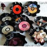 Svuotatasca in vinile da disco