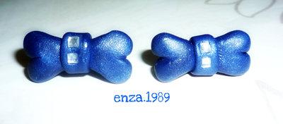 Orecchini in fimo..fiocchetti blu