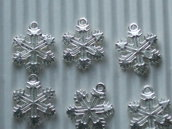 10 charms fiocchi di neve in metallo  vend.