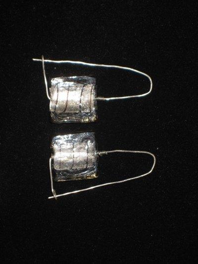 Orecchini in filo d'argento fatti a mano