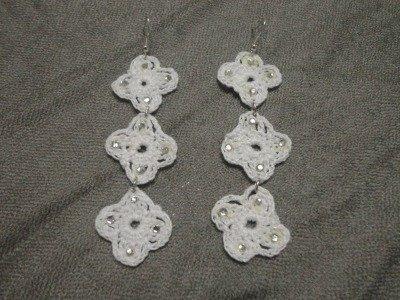orecchini bianchi , stile Cruciani con strass