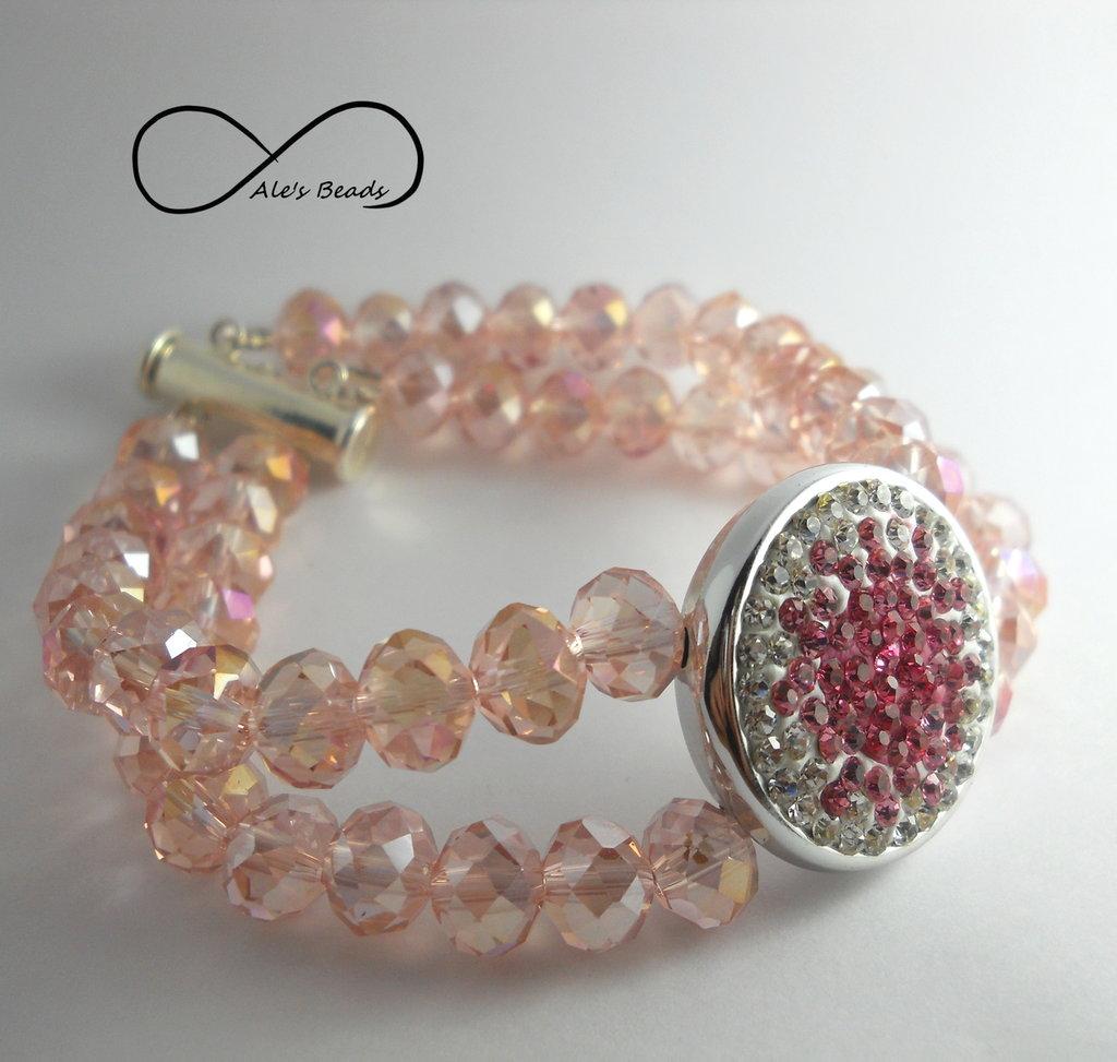 Bracciale a filo doppio con pietre sfaccettate rosa e inserto in metallo con strass
