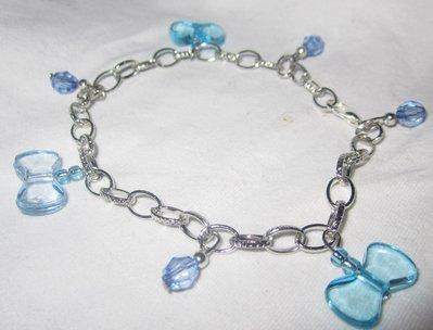 bracciale color acciaio con perline e fiocchi