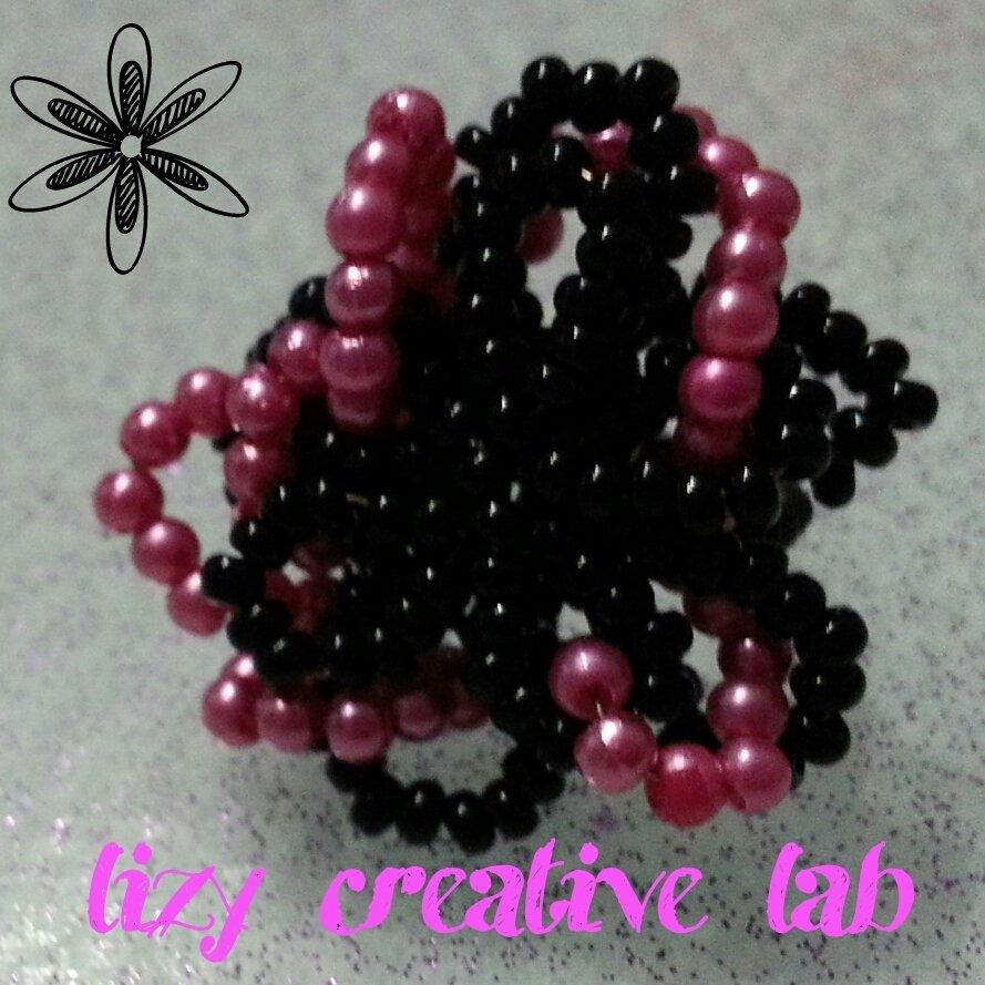 Anello fiore nero e rosa