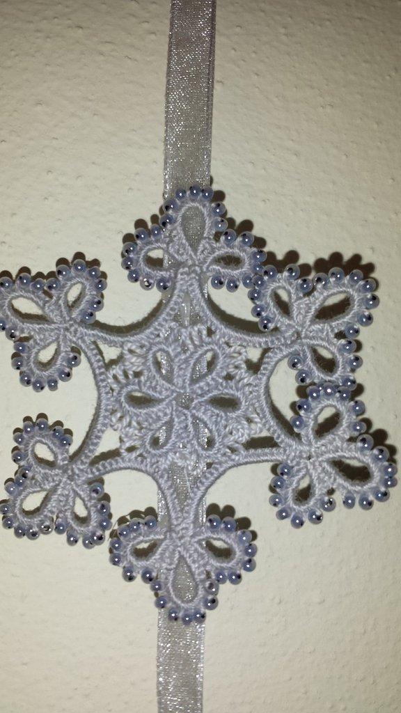 Decorazione Natalizia: ghirlanda con fiocchi di neve
