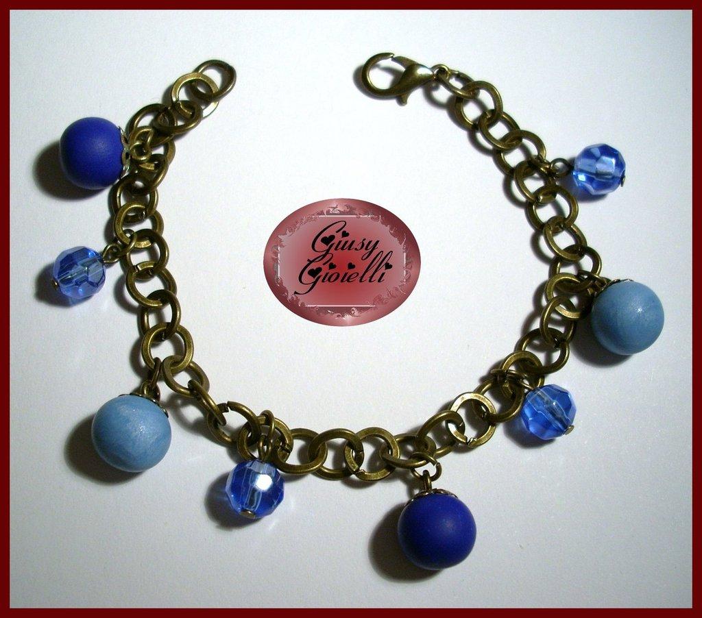 Braccialetto bronzo con charms azzurri