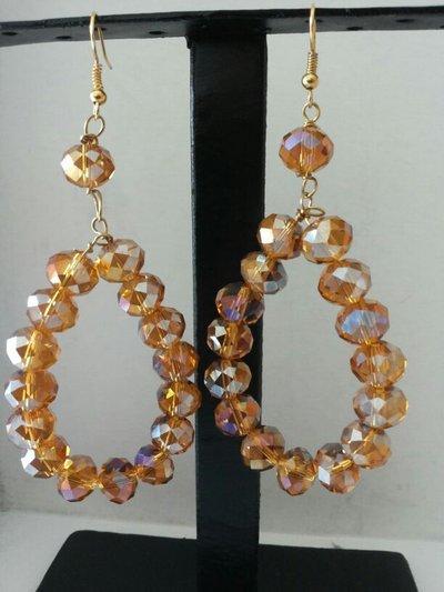orecchini a cerchio con cristalli di luce