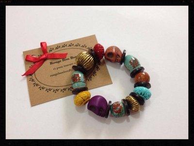 Bracciale etnico con perle e teschi