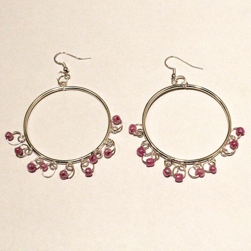 Orecchini cerchio con perline rosa